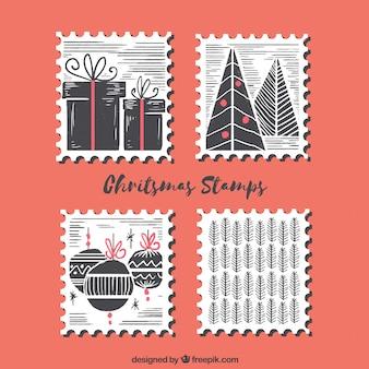 Conjunto de quatro selos de natal desenhados a mão