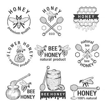 Conjunto de rótulos monocromáticos com mel, abelhas e favo de mel