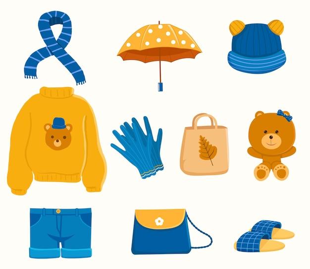 Conjunto de roupas de outono amarelas e azuis