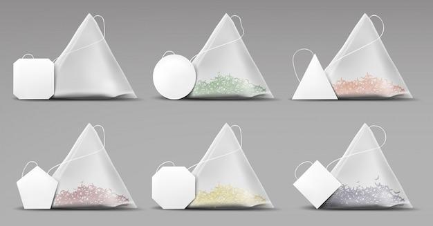Conjunto de sacos de pirâmide de chá isolado na cinza