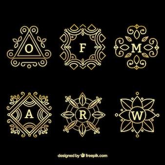 Conjunto de seis monogramas de ouro