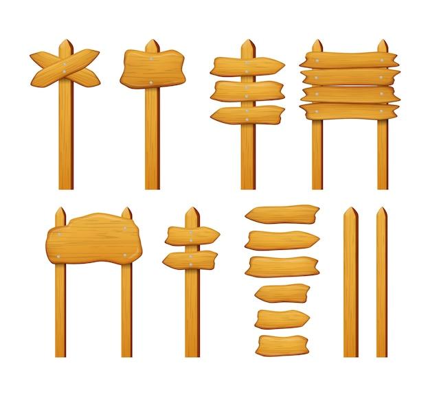Conjunto de setas e placas de sinal de madeira isolado no branco.