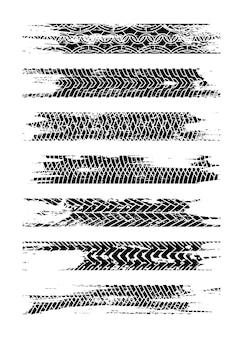 Conjunto de silhueta de faixa de pneu preto. trilha de pneu grunge isolada
