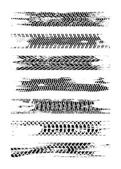 Conjunto de silhueta de faixa de pneu preto. trilha do pneu de grunge isolada. faixa de pneu com manchas de tinta. splatter de estrada de pista de pneu