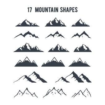 Conjunto de silhuetas de montanha de mão desenhada.