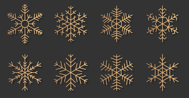 Conjunto de silhuetas elegantes de ícones de flocos de neve de ouro. neve para o banner feliz natal e feliz ano novo