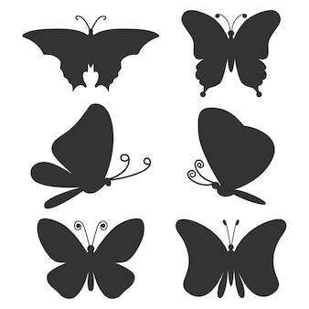 Conjunto de silhuetas negras de borboletas isoladas em um fundo branco