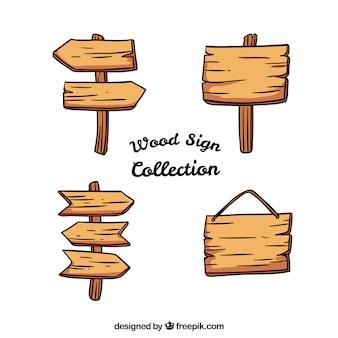 Conjunto de sinais de madeira desenhados a mão