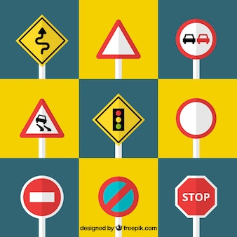 Conjunto de sinais de trânsito em design plano