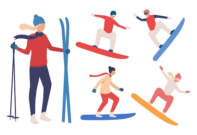 Conjunto de snowboarders e esquiadores