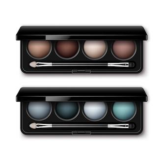 Conjunto de sombras redondas e multicoloridas, marrom claro, creme, ocre, azul escuro, cinza claro, em caixa de plástico retangular preta com aplicação de pincel de maquiagem, vista superior isolada.