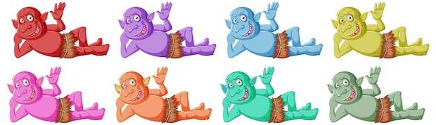 Conjunto de sorriso colorido goblin ou troll enquanto está deitado no personagem de desenho animado