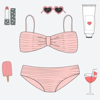 Conjunto de suíte de natação rosa e acessórios em férias de verão