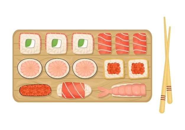Conjunto de sushi e rolos em uma placa de madeira. comida japonesa.