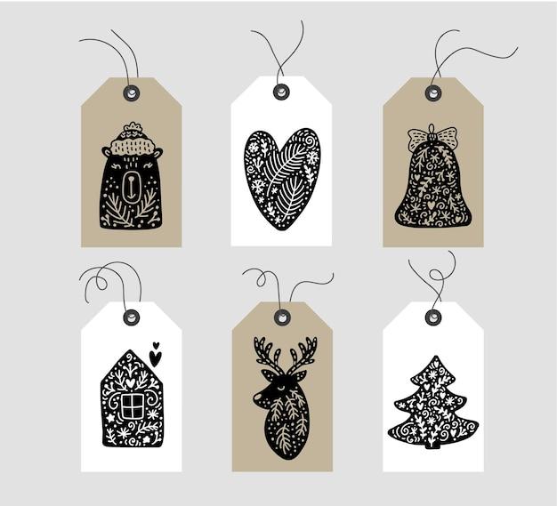 Conjunto de tags de elemento de natal escandinavo de doodle desenhado à mão. coleção de etiquetas de presente de vetor de férias de inverno