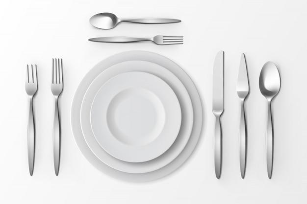 Conjunto de talheres de vetor com garfos de prata, colheres e facas
