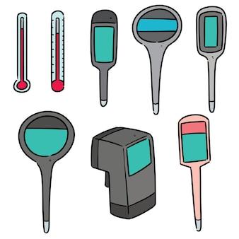 Conjunto de termômetro isolado no branco