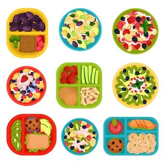 Conjunto de tigelas com saladas de frutas e lancheiras com comida. alimentação saudável. pratos saborosos no café da manhã