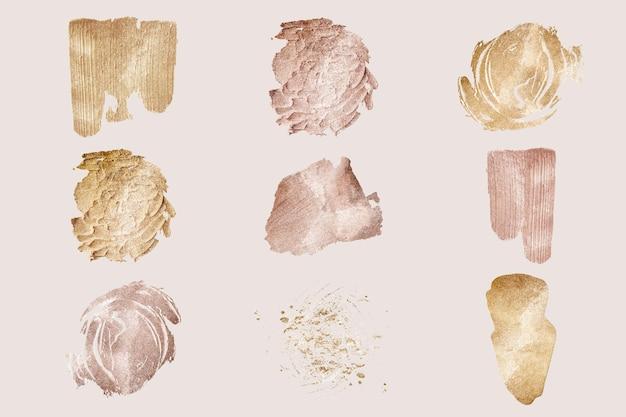 Conjunto de tinta dourada com purpurina manchada