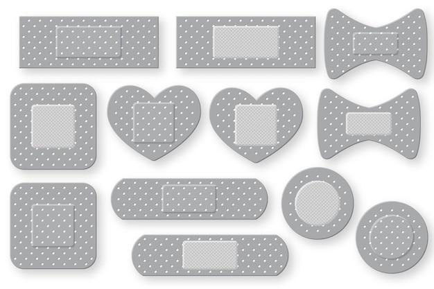 Conjunto de tira de gesso de primeiros socorros realista. patch de bandagem elástica. isolado no fundo branco.
