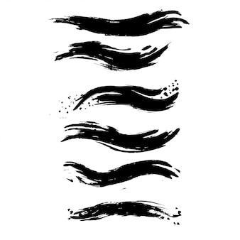 Conjunto de traçados de pincel de tinta áspera.