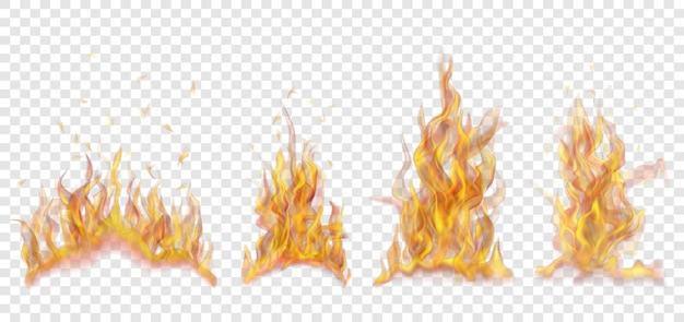 Conjunto de translúcidas fogueiras ardentes de chamas e faíscas em fundo transparente. para uso em fundos claros. transparência apenas em formato vetorial