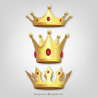 Conjunto de três coroas de ouro com gemas vermelhas