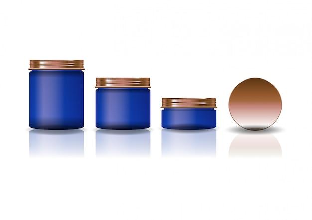 Conjunto de três tamanhos azul redondo frasco cosmético com tampa de cobre.