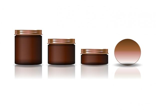 Conjunto de três tamanhos marrom redondo frasco cosmético com tampa de cobre.