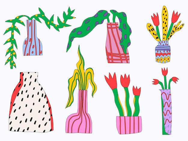 Conjunto de vasos com flores e plantas