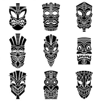 Conjunto de vetores de silhuetas negras de máscara tribal tiki.