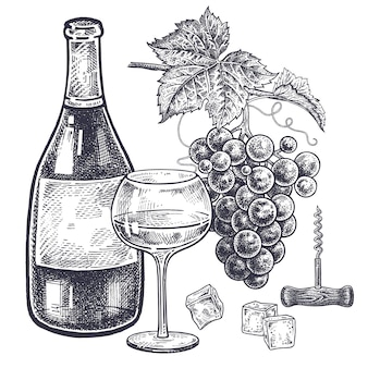 Conjunto de vinho e uvas.
