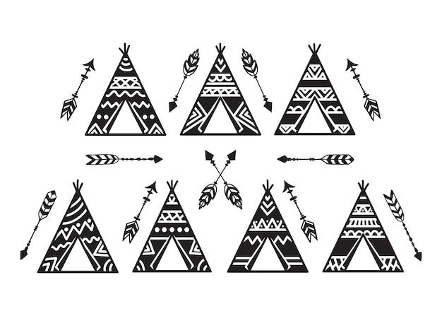 Conjunto de wigwams de mão desenhada e flechas.