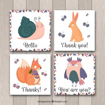 Conjunto desenhado à mão de cartões de animais divertidos