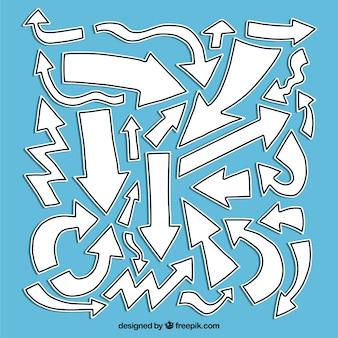 Conjunto desenhado à mão de setas brancas