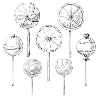 Conjunto desenhado de mão de diferentes pirulitos. ilustração de um estilo de desenho.