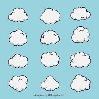Conjunto desenhado mão de nuvens brancas