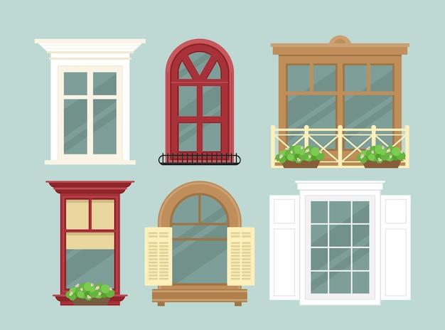 Conjunto detalhado de várias janelas coloridas com flores, decorações e peitoris, cortinas