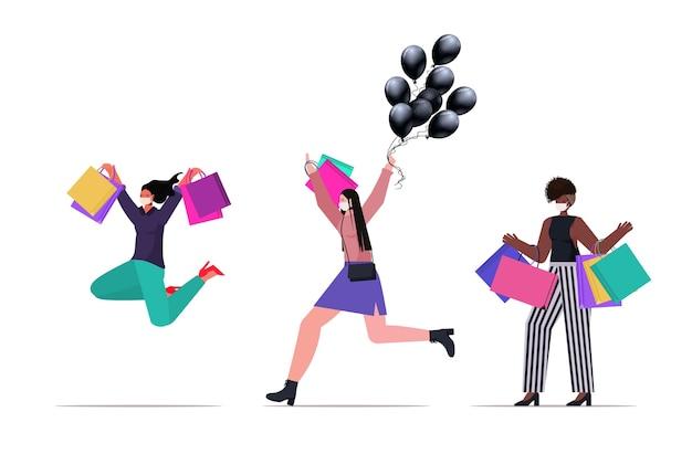 Conjunto mix raça pessoas com máscaras segurando sacolas de compras preto sexta-feira grande promoção promoção desconto coronavirus quarentena conceito isolado