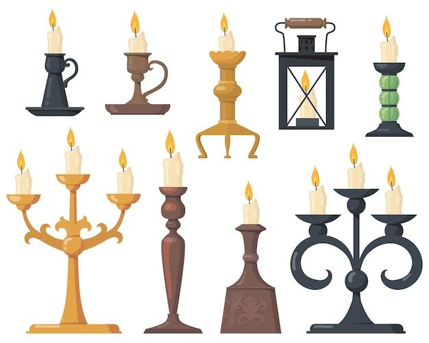 Conjunto plano de velas vintage em castiçais. candelabros vitorianos elegantes dos desenhos animados e suportes retrô para a coleção de ilustração vetorial de velas isoladas. elementos de design e conceito de decoração