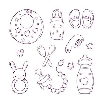 Conjunto preto e branco desenhado à mão de brinquedos e acessórios para bebê