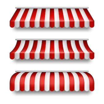 Conjunto realista de toldos listrados isolado no fundo. clipart com tendas vermelhas e brancas
