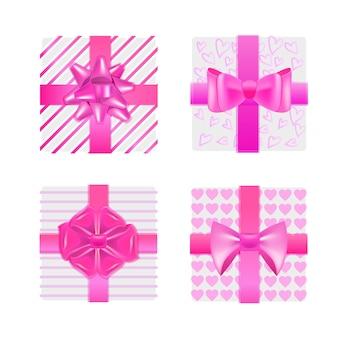 Conjunto rosa embrulhado caixas de presente com arcos conceito de celebração do dia dos namorados