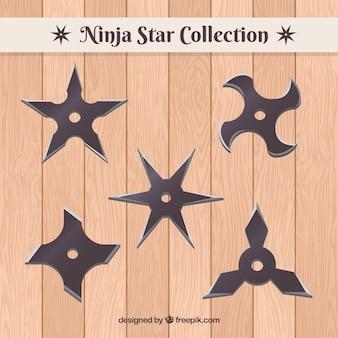 Conjunto tradicional de estrelas ninja com design plano