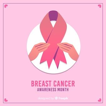 Conscientização do câncer de mama com fita e mãos