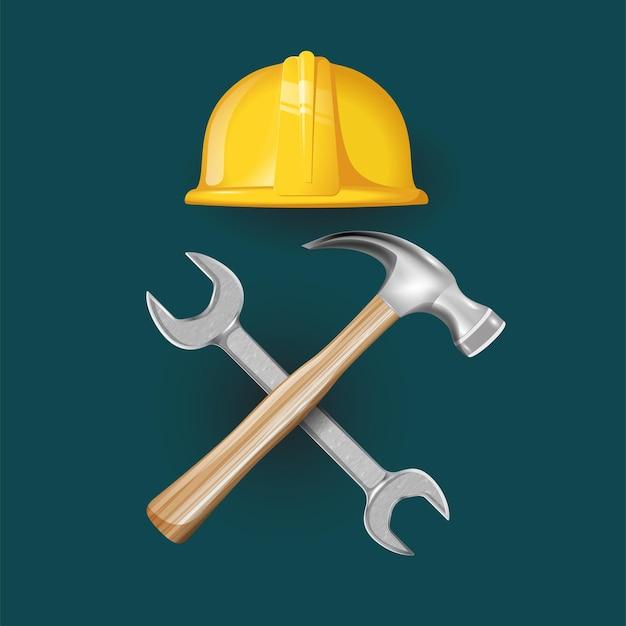 Construção de capacete com martelo e chave de ferramentas cruzadas