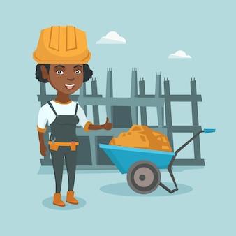 Construtor afro-americano novo que dá o polegar acima.