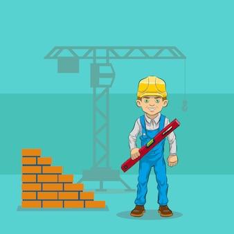 Construtor alegre segurando um nível de bolha