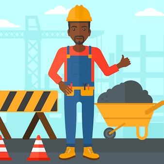 Construtor aparecendo polegares.