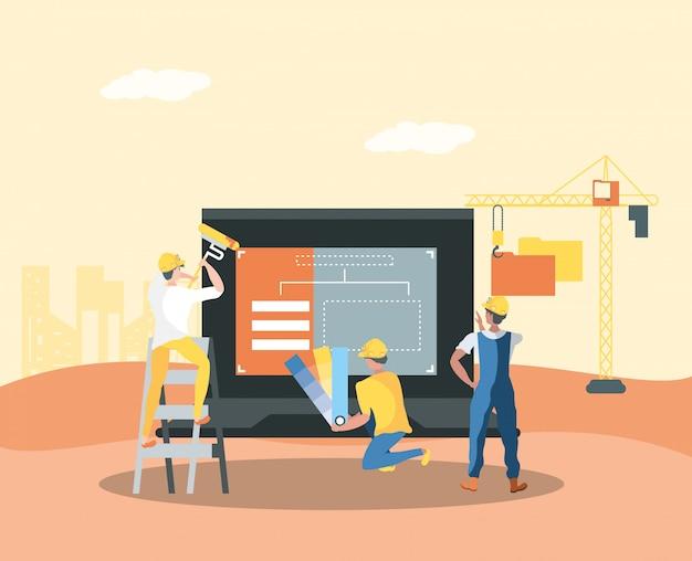 Construtor e laptop com página da web em construção